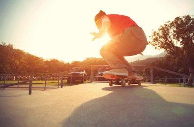 Skateboarder legs doing  trick ollie