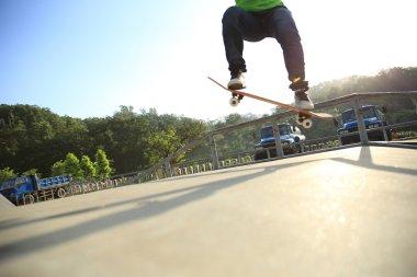 Skateboarder legs doing a trick ollie