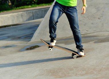 Skateboarder legs at skatepark