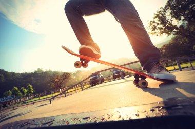 Skateboarder legs doing  trick