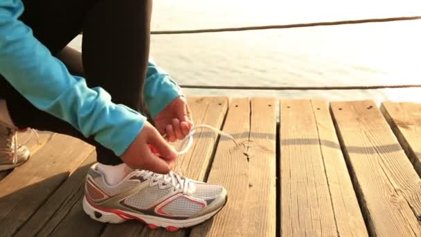 sports woman tying shoelace