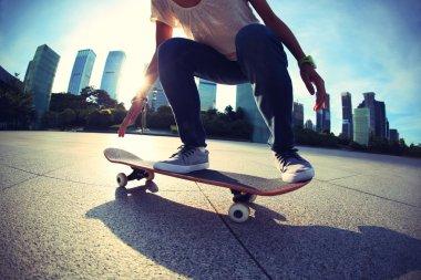 female skateboarding at city