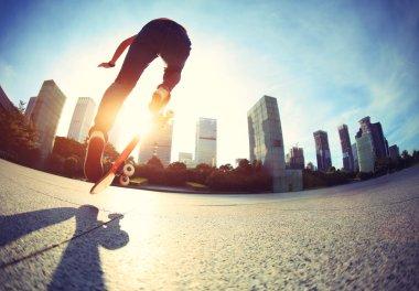 Female Skateboarder skateboarding at sunrise city stock vector