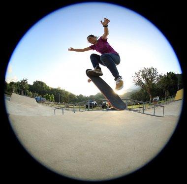 female Skateboarding at skatepark