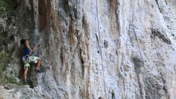 Climber climbing rock
