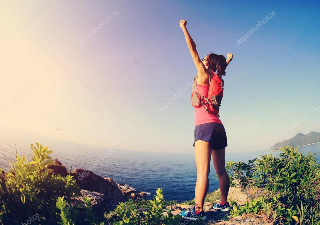 cheering woman  with open arms