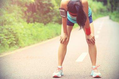 woman runner taking rest