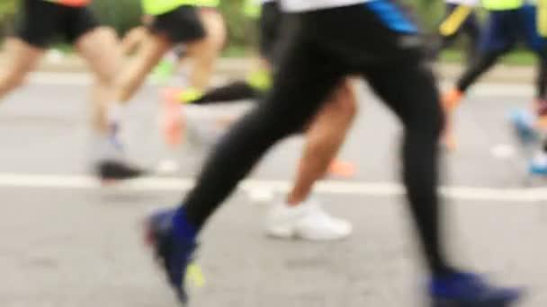 marathon runners on city road.