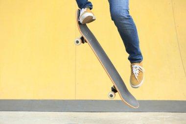 skateboarder with skateboard at park