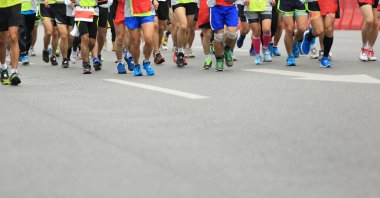 Marathon runners running on road