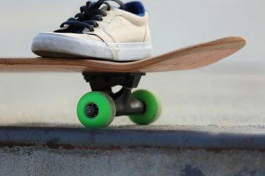 teenager sneaker on skateboard
