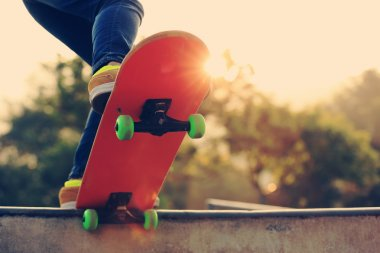 female skateboarder with board