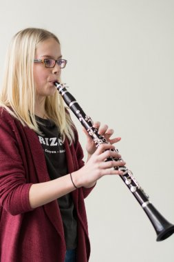 Youth plays clarinet