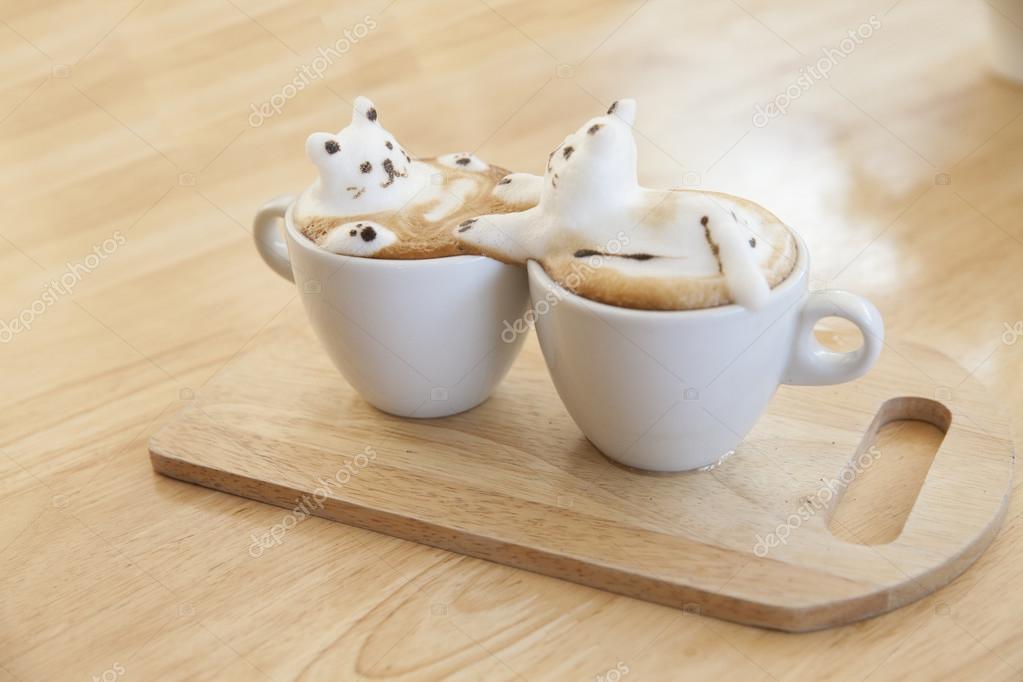 https://st2.depositphotos.com/2152431/7481/i/950/depositphotos_74817557-stock-photo-top-view-of-latte-coffee.jpg