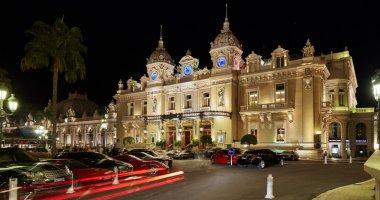 Monaco, Monte-Carlo, 04.09.2015: Casino Monte-Carlo in the night, hotel de Paris, night illumination, luxury cars, players, tourists, fountain, cafe de paris, long exposure, summer