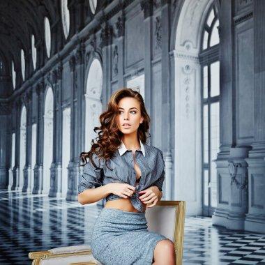 Beautiful girl in a striped shirt and tight skirt, black bra, cu