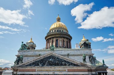 Russia, St. Petersburg, Isaac's Cathedral, 07.14.2015: A view of Isaac's Cathedral from 5 floors of the hotel 4 season, around the cathedral are many tour buses and tourists, a lot of people walking upstairs colonnade, sunny, white cloud
