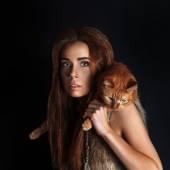 Fotografie Höhlenmenschen Mädchen und Katze