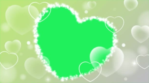 Animace bílá srdce s rámečkem tvaru srdce na zeleném pozadí.