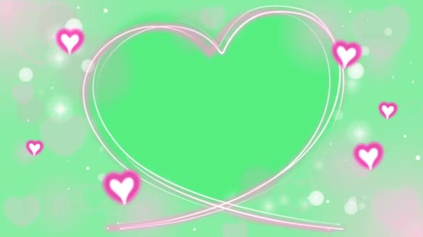 Animation rosa Herzen mit herzförmigem Rahmen auf grünem Hintergrund.