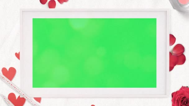 Realistic white picture frame and red heart with green space.