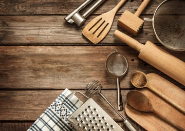 Rural kitchen utensils on vintage wood table from above