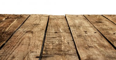 Old vintage planked wood table in perspective