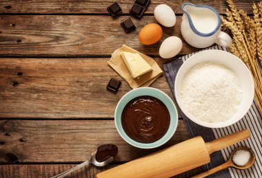 Baking chocolate cake - recipe ingredients on vintage wood