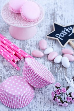 Sugar coated candies, cupcake baking cups, macaroons, pink straws
