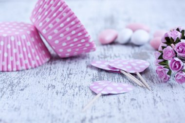Sugar coated candies, cupcake baking cups