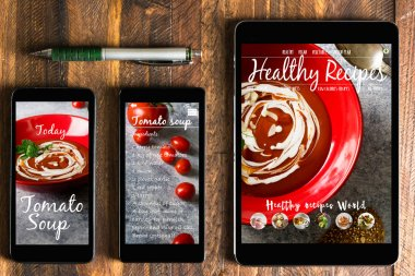 With tablet and smartphone healthy recipes blog on screen. Web o
