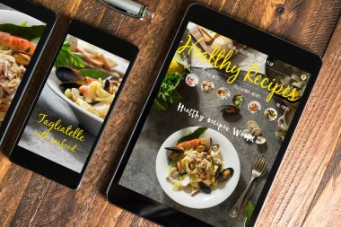 tablet and smartphone healthy recipes blog on screen. Web on th