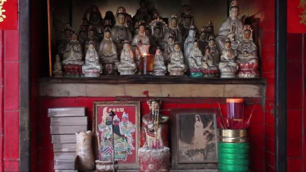 Altar of small street side Chinese shrine in Macau