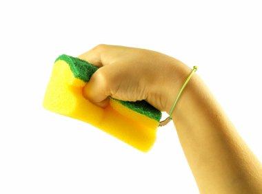 Yellow sponge for washing utensils on hand