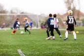 rozmazané fotbal děti