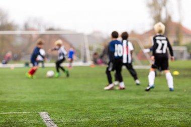 Blurred soccer kids