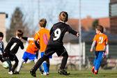 Fényképek Fiatal fiú-labdarúgó-mérkőzés alatt
