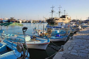 Pleasure boat, a replica of the famous Black Pearl anchored surrounded by fishing boats in the bay of Ayia Napa