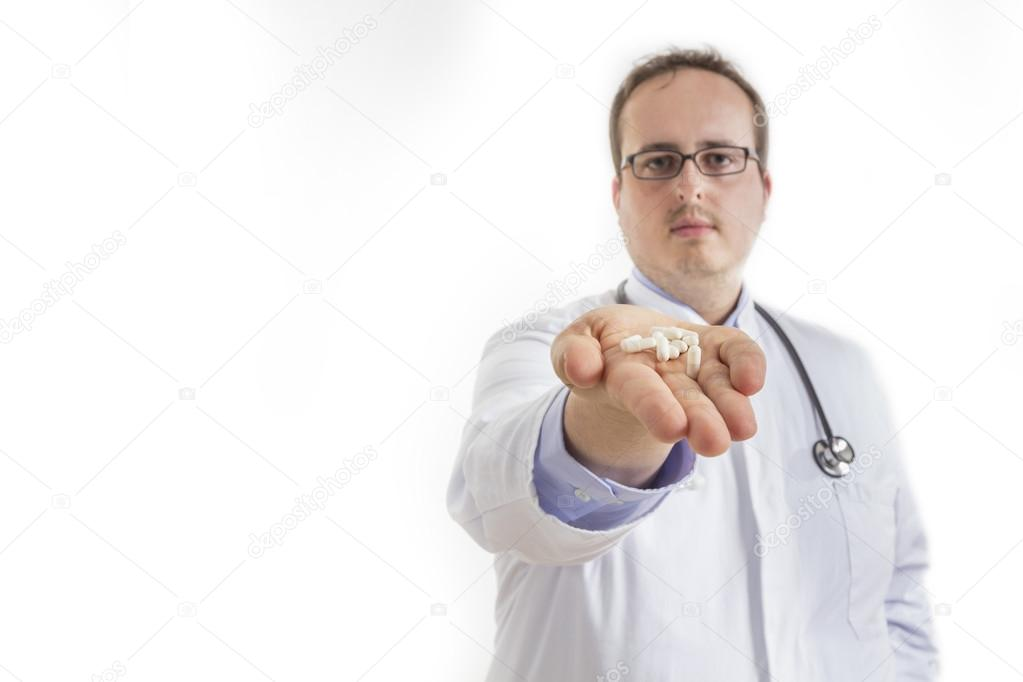 young doctor handing out pills stock photo kunertus 54202657