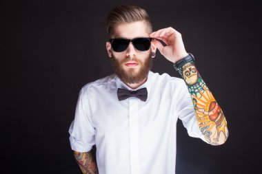 young fashionable hipster man in white shirt