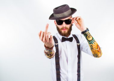 portrait of a stylish hipster showing his f-finger
