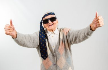 bohemian grandma with a tie on her forehead