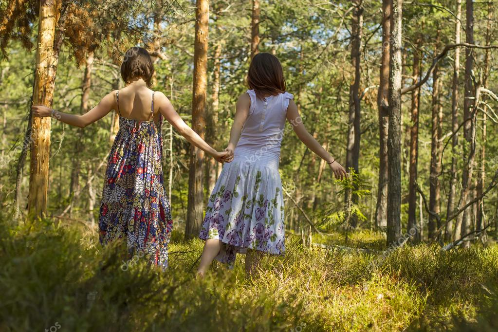 two women walking in the forest