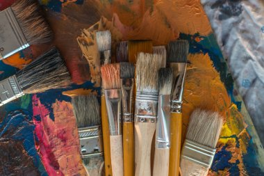 Paintbrush collection on old palette