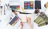 Artist drawing graphic sketch at sketchbook.