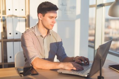 Man typing text or blog in office