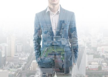Double exposure businessman and city