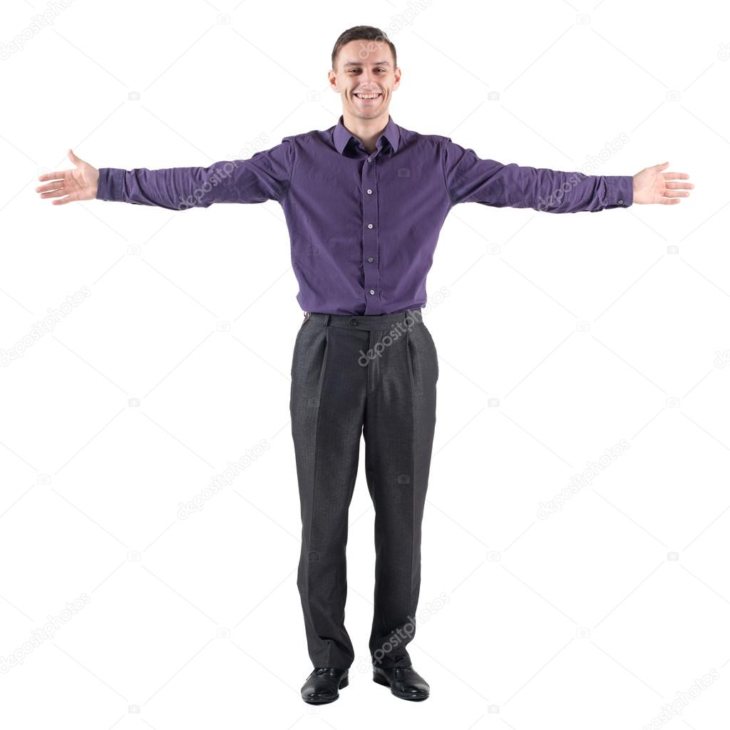 young casual man welcoming you white background with hands on the sides