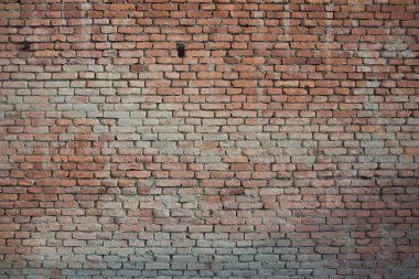 Old vintage brickwall street rusty grunge aged rough wall background texture.
