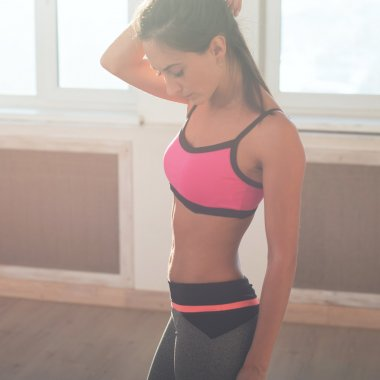 Gorgeous young athletic active sportive woman in sport outfit